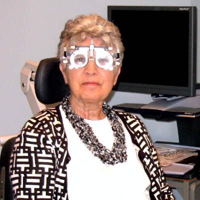 Image of adult woman with an ophthalmic testing device on her face.