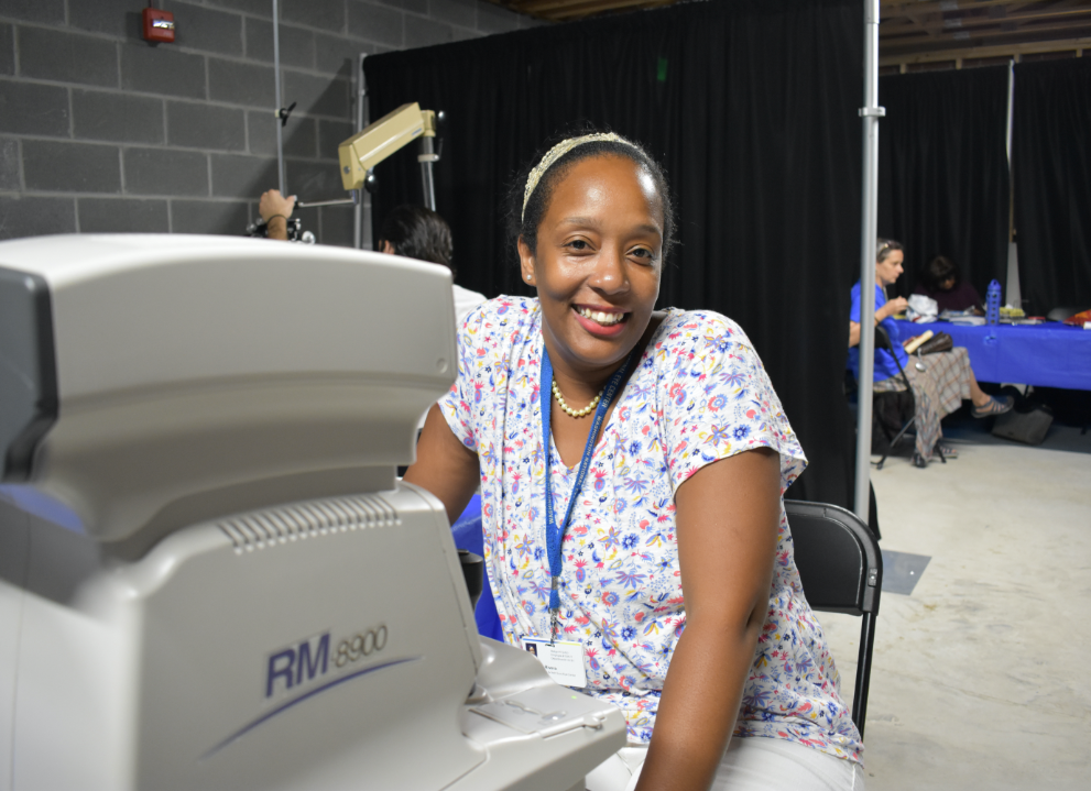 Image of an adult woman volunteering at an eye health-related event.