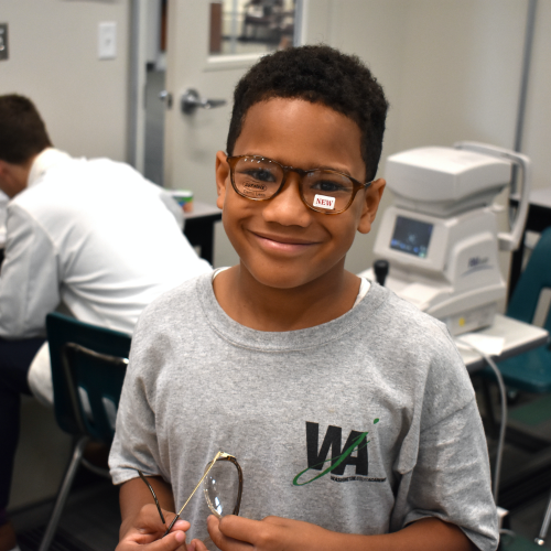 Image of child wearing glasses.